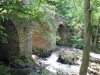 kamenný most s peřejemi u Toušic