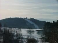 Pohled z Mariánské Hory na Tanvaldský Špičák