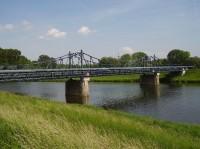 Kostelany nad Moravou: Most přes řeku Moravu u Kostelan. Jeho stavba zahájena v r. 1912 a dokončena 1921.
